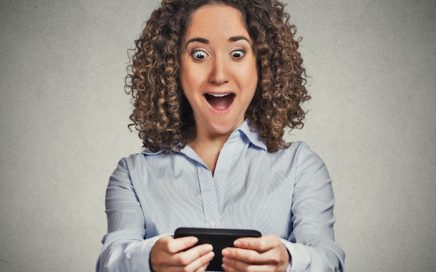 woman happy to receive text message